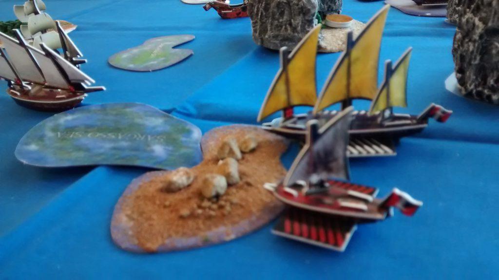 Corsair galleys docked at wild island
