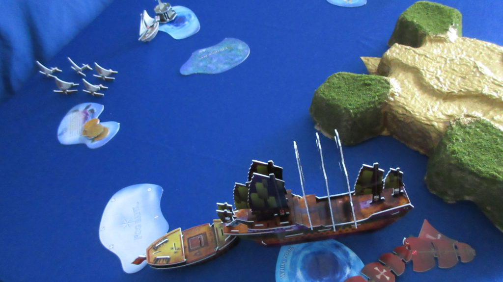 The Eighth Wonder captures the Cristal del Obispo! The native canoes have deposited their 5 coins and head north.